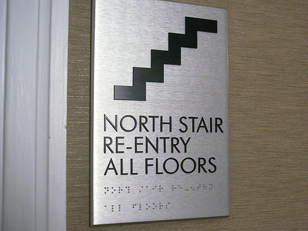 Stairs are displayed on a sign that reads