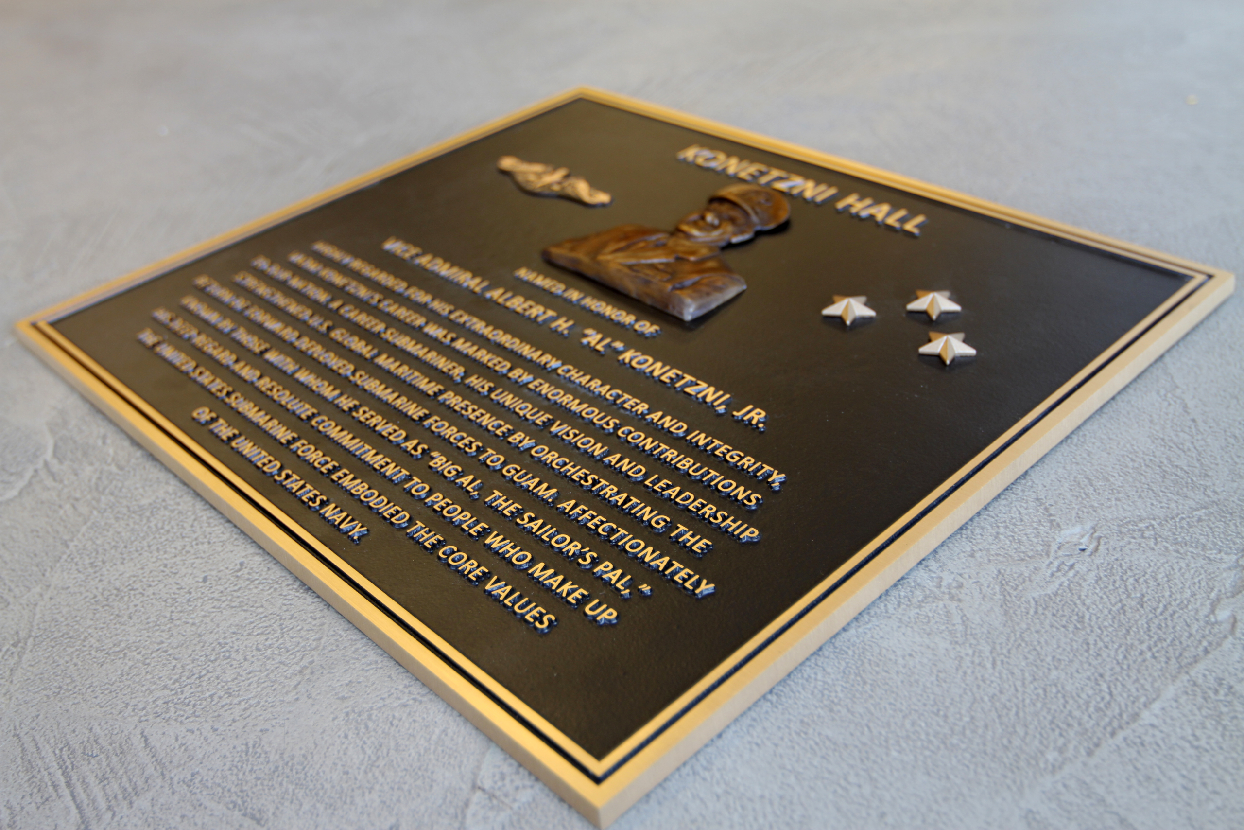 A placard memorializing a person who served in the Navy.